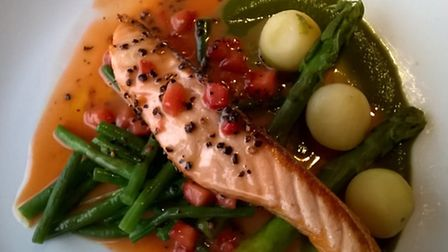 CAPTION: Grilled salmon over asparagus puree with pearl potatoes, buttered beans and strawberry and