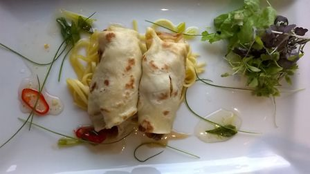 CAPTION: Oriental seasoned duck pancakes with sweet chilli and spring onion sauce, wamr noodles and