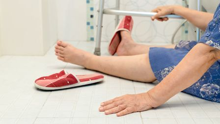 An elderly woman falling in the bathroom because of slippery surfaces
