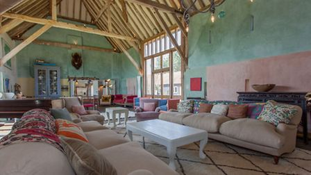 The tithe barn makes a spectacular entertaining space and is stuffed with character and colour, warm