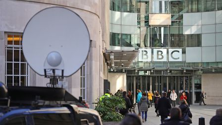 Media trucks outside BBC Broadcasting House in London. Photograph: Aaron Chown/PA.