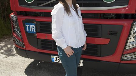 Samara in front of one of the 46 lorries she has sent to Iraq, Syria and Jordan to support displaced