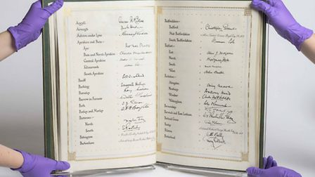 An illuminated book signed by every Member of the House of Commons in 1954, given to Winston Churchi