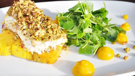 Baked cod with pistachio crust, mango purée, spiced polenta chips and watercress