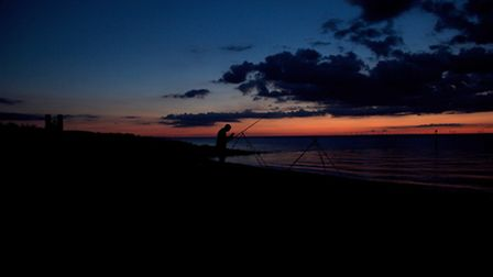 """1st Place: Rabiah Singh from Canterbury, Fisherman on Reculver Beach. """"A well-seen and executed imag"""
