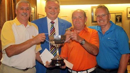 Receiving the Trophy from M and T Captain Paul Butler are Ian Appleton, Les Ross and Graham Davenpor