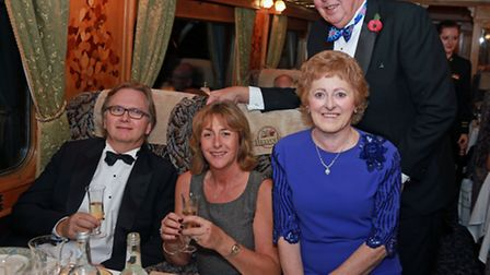 Celebrating their 30th anniversary are Jeff and Cherry Batson (left) with Margaret and Elliott Black