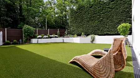 The rear garden is laid with astroturf