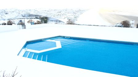 Christmas at Saunton Sands hotel. The outdoor pool and the beach are covered in snow.