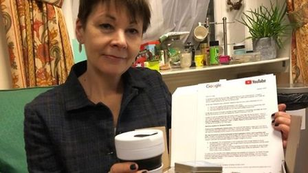 Caroline Lucas holds a package from Google. Photograph: Twitter.