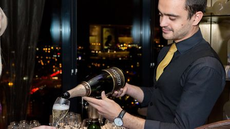 A waiter pouring champagne
