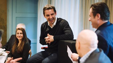 Gary Neville speaking with guests