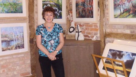Lynda Kettle with some of her paintings