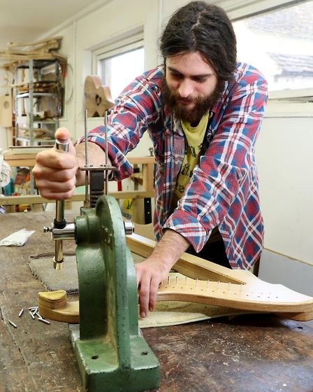 Charlie Orme uses the vintage press used to make the harps