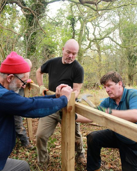 Conservation volunteers at work on Cheshire Wildlife Trust land