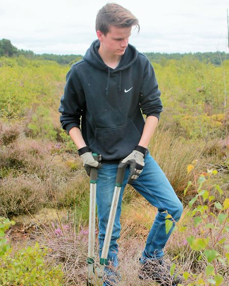 A conservation volunteer at work on Cheshire Wildlife Trust land