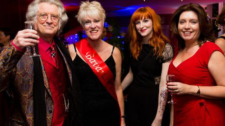 Patron Noddy Holder with volunteers Josie and Christa Collier, and patron Suzan Holder