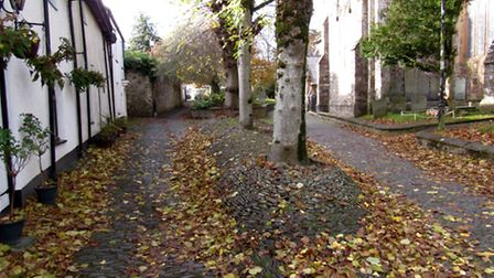 Cobbled mound outside the parish church: the grave of those who died in the church explosion during