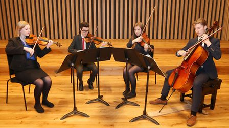 6th form string quartet students in The Stoller Hall at Chetham's School of Music