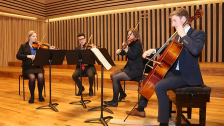 6th form string quartet students rehearse in The Stoller Hall at Chetham's School of Music