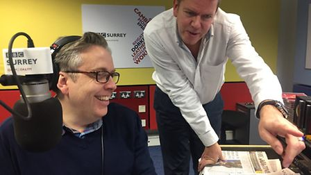 James chats over a story with managing editor, Mark Carter
