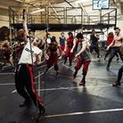 Andrew Polec and the cast in rehearsal