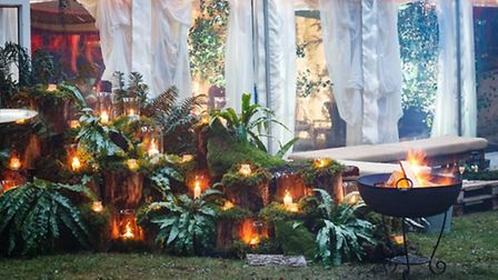 Moss covered tree stumps and glowing candles decorate the estate (c) Oasis Events