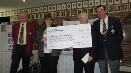Debra Millican receiving the Cheque for £9126.61 from Maggie Lee (Lady Captain) watched by President