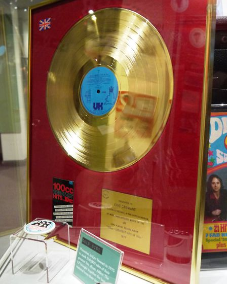 A gold record presented to Eric Stewart in 1977 for sales of the album 100cc - Greatest Hits of 10cc