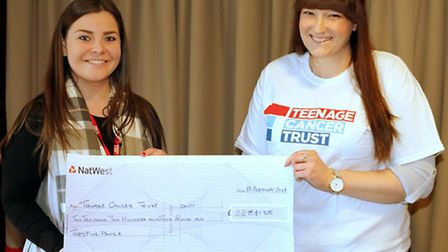 Lindsay hands over the cheque to Sabina