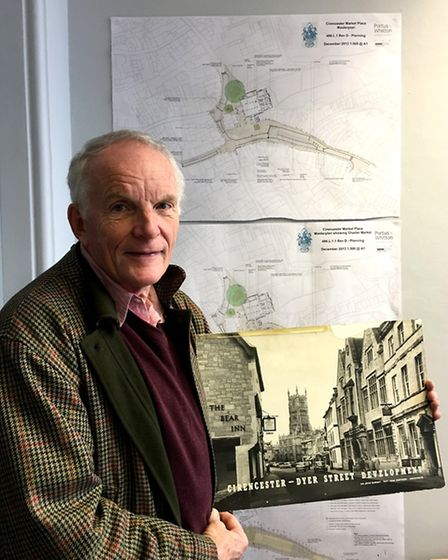 Cirencester's deputy mayor Nigel Robbins with a picture of old Cirencester against the new plans
