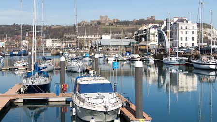 Dover's busy harbour with the Castle in the background