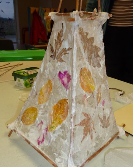 Willow framed paper lantern decorated with pressed leaves and flowers. Picture by Anne Brenchley