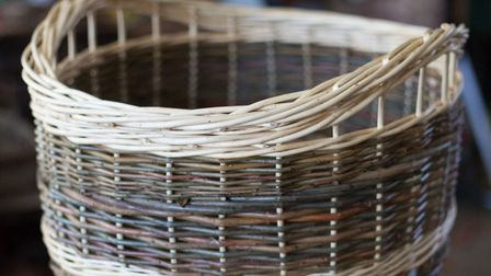John makes traditional crafts such as these sturdy log baskets