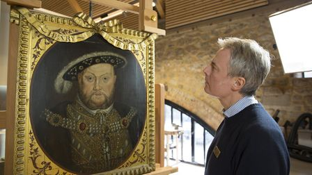 Senior conservator Gerry Alabone with the ribbon-framed painting of Henry VIII