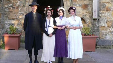 The Rev'd Mark Brown, Vicar of Tonbridge Parish Church, with Gill Dunn (far right) and her daughters