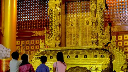 Burma's Lost Royals look on at the Lion Throne from which their ancestors ruled Burma, Yangon Decemb