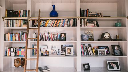 The floor to ceiling shelves are perfect for storage and fun to use – they require ladder access