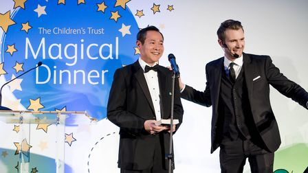 On stage with The Children's Trust's CEO Dalton Leong
