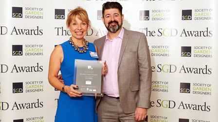 Joanne receiving her trophy from Paul Boylin, senior marketing manager for The Millboard Company at