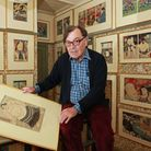 Frank's collection in his hallway reaches to nearly 100 images