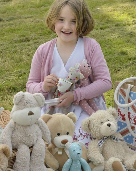 Olivia Doran,10, from Eggesford feeding up her teddies for the Bampton Spring Fest parachute event