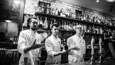 Crazy Eights barmen showing off their skills