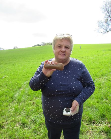 Joy Beresford shows a 5,000-year-old adze she found at Weaverham.