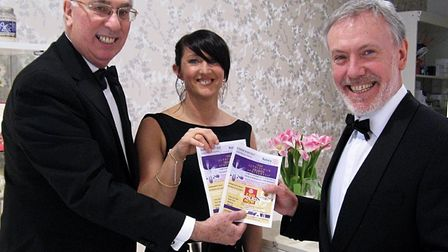 Ken Garrity from Altrincham Rotary Club presenting tickets to Sonia Stanley and Martin Duff owner of