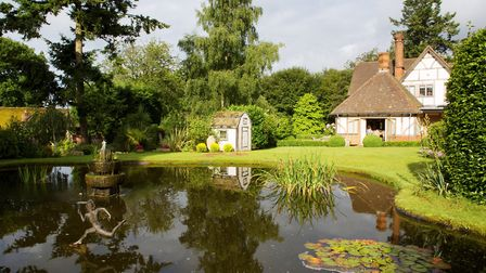 The tranquil scene across the pond to the house