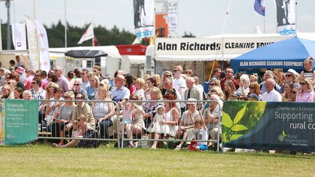 Spectators gather around the main ring, which this year is sponsored by Delamere Dairy