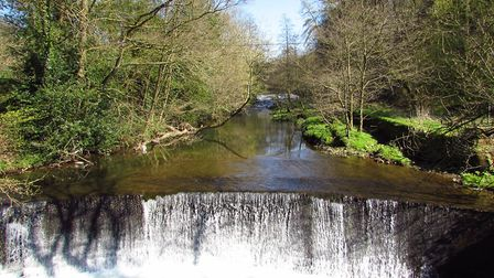 View of weir on the River Dane from the footbridge