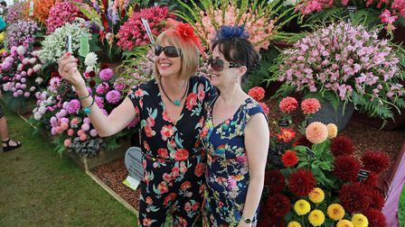Hilary Chalmers and Jenny Sech pose with a display of dahlias and gladioli in the Floral Marquee at