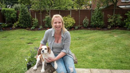 A delighted Elizabeth Hardy in her transformed Bowdon garden with the hard-working I Want Trees team